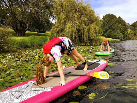 SUP Yoga on a river in New Zealand