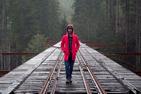Red raincoat for the perfect camping trip. Waterproof and windproof.