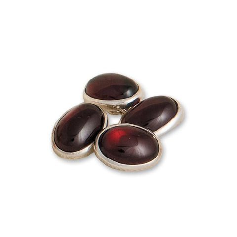 A pair of silver and garnet oval cufflinks with chain connectors
