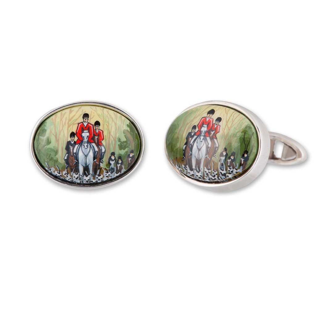 A pair of silver and enamel hand painted cufflinks with hunting scenes