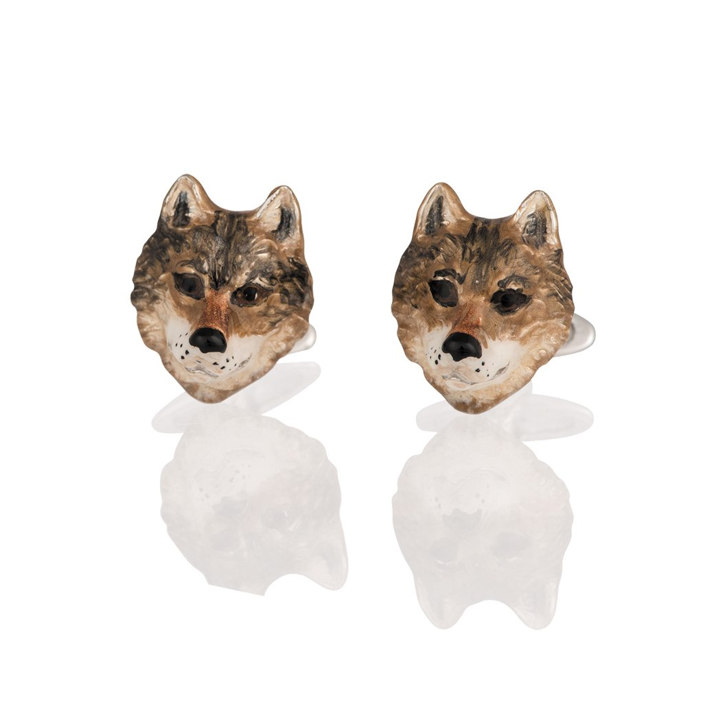 A pair of silver and enamel wolf's head cufflinks