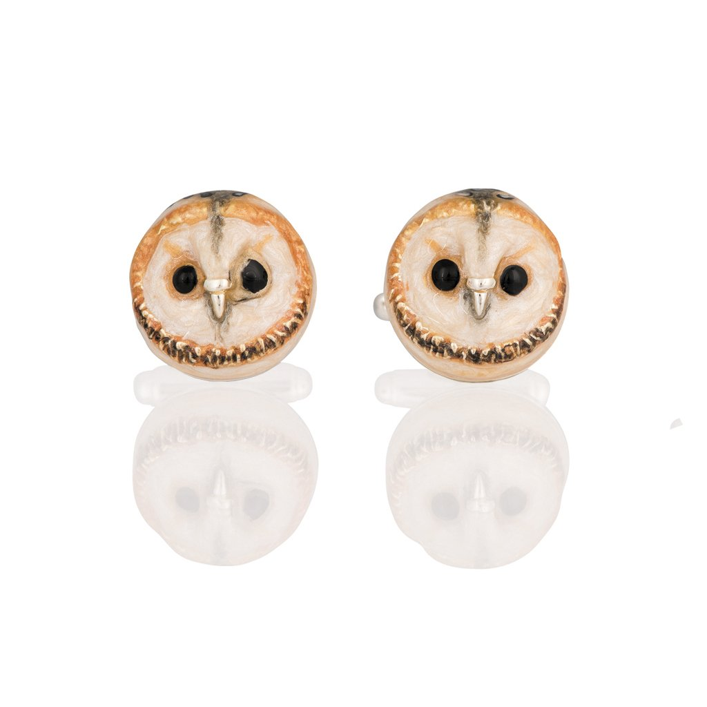 A pair of silver and enamel owl cufflinks