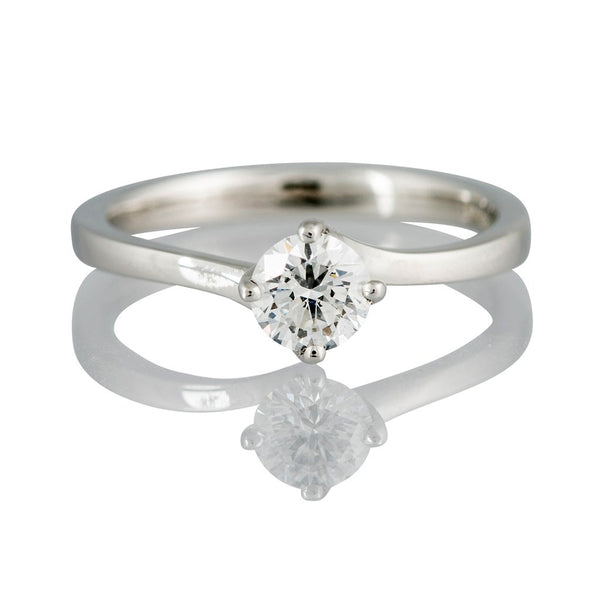 An Ogden of Harrogate 'Rosina' platinum and diamond twist ring. Diamond: certificated 0.51cts