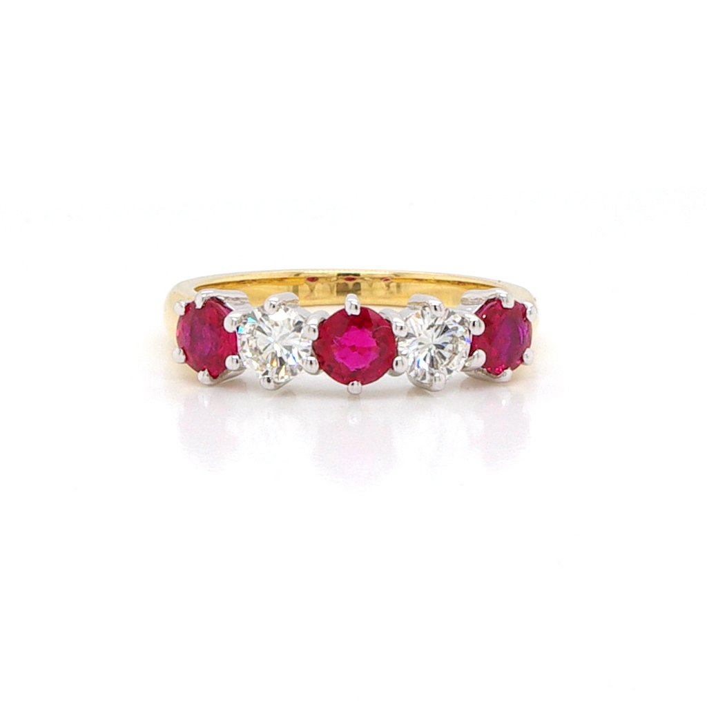 An 18ct white and yellow gold, ruby and diamond half eternity ring 1.38cts