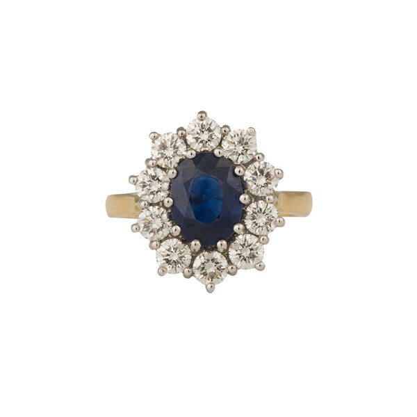 An 18ct yellow and white gold, sapphire and diamond cluster ring 3.32cts