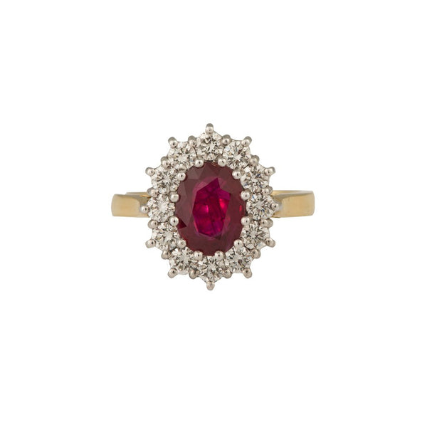 An 18ct yellow and white gold, oval ruby and diamond border ring 3.04cts