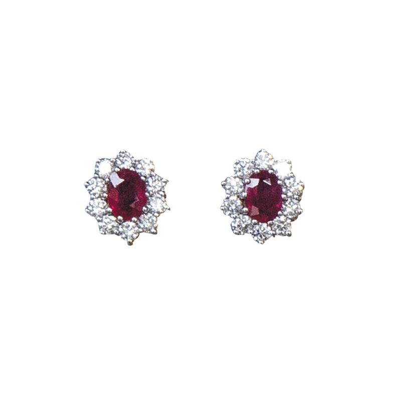 A pair of 18ct gold, ruby and diamond cluster earrings. Rubies: 1.45cts; diamonds: 1.42cts
