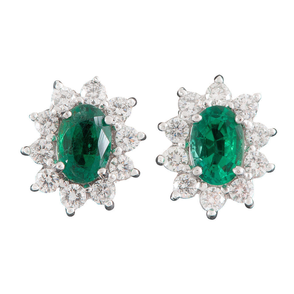 A pair of 18ct yellow and white gold, oval emerald and diamond cluster earrings.