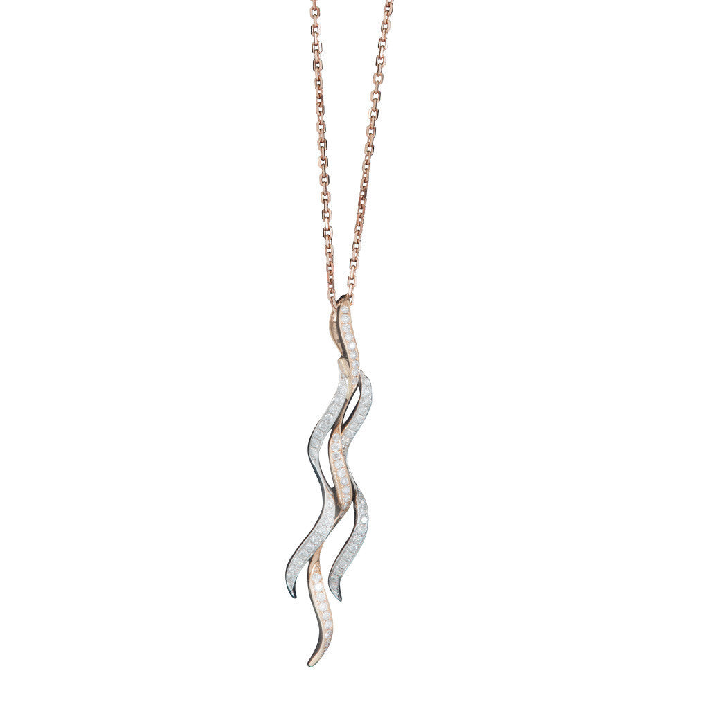 An 18ct rose and white gold and diamond 3 strand pendant