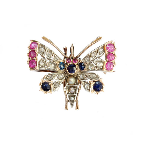 A 9ct yellow gold and silver, multi gem set butterfly brooch