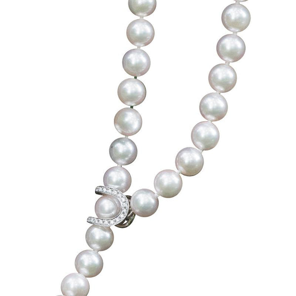 A cultured pearl, 18ct white gold and diamond lariat necklace