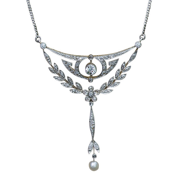 An Edwardian 15ct gold, platinum, diamond and pearl floral drop pendant on curb chain