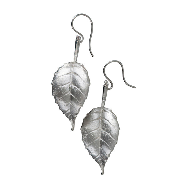 A pair of Andrew O'Dell silver leaf earrings.