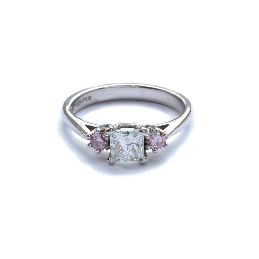 A platinum, square diamond and pink diamond ring 0.74cts