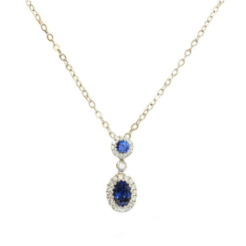 An 18ct white gold, oval and round sapphire and diamond pendant 0.89cts