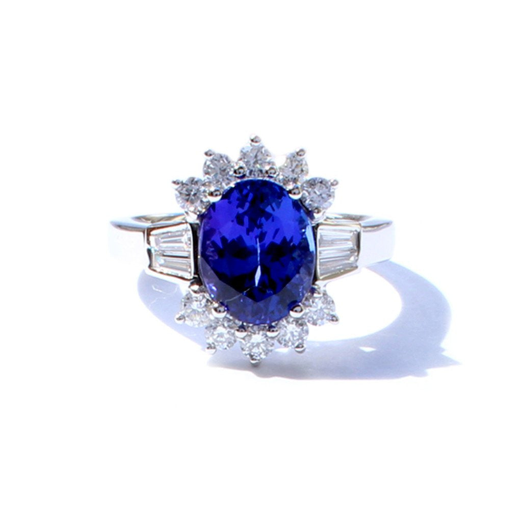 An 18ct white gold, oval tanzanite and diamond border ring 3.82cts