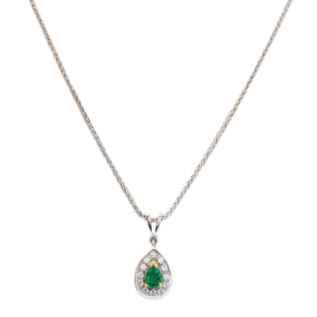 An 18ct white gold, tear emerald and diamond drop pendant 0.22cts