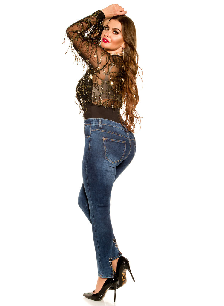 Sexy Curvy Girl Plus size jeans with black bows and zip decorations.
