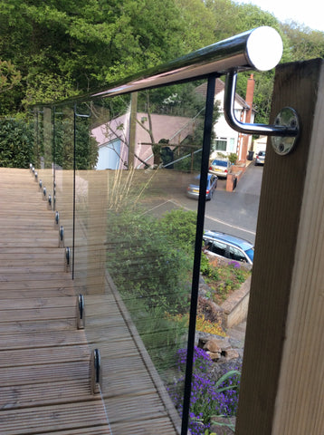 Glass balustrade combined with slotted handrail