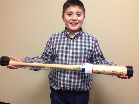 Felix holding Banks Signed Bat