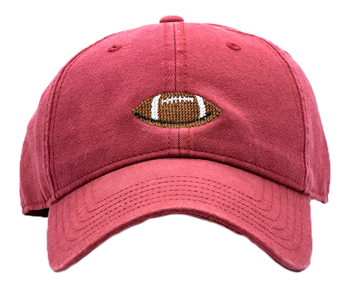 Football on Weathered Red Hat
