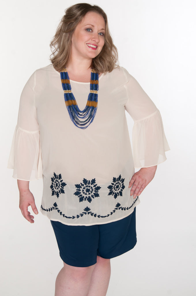 Floral embroidered bell top