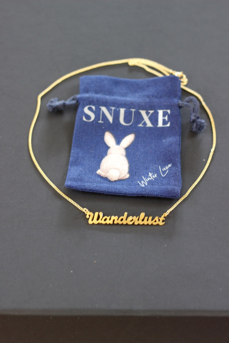 """WANDERLUST"" Gold necklace"
