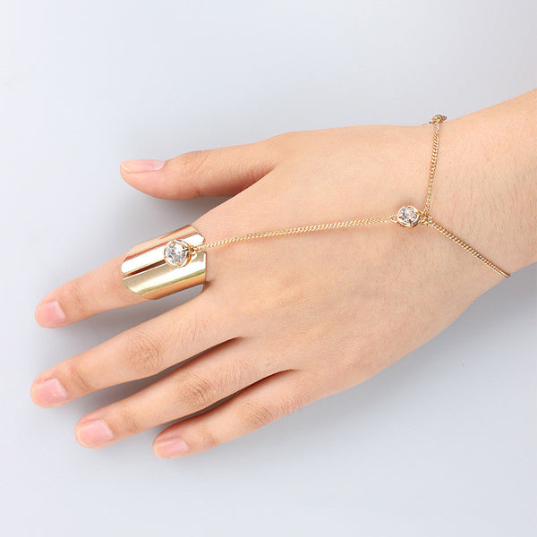 Statement ring finger bracelet with crystal stone