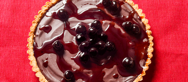 Dark Chocolate Ganache Tart with Cherry-Vodka Sauce