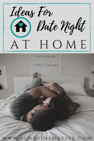 Ideas For Date Nights At Home, couple cuddled up in bed