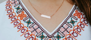 Sunshine Native Handmade Jewelry, Custom Stamped Bar Necklace modeled on woman