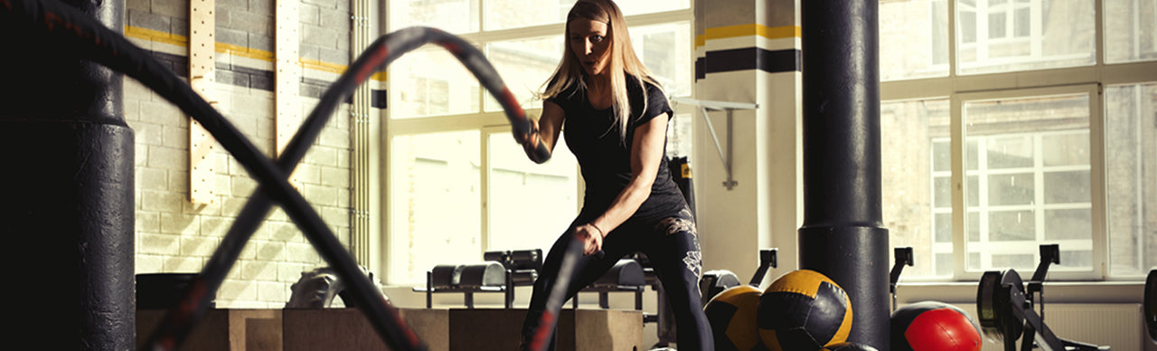 image of woman exercising at the gym