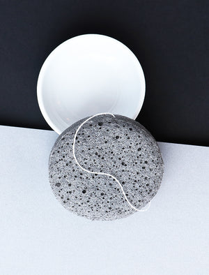 picture of charcoal sponge in a round dish