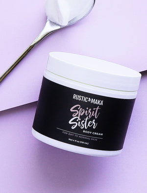 image of spirit sister body cream with spoon
