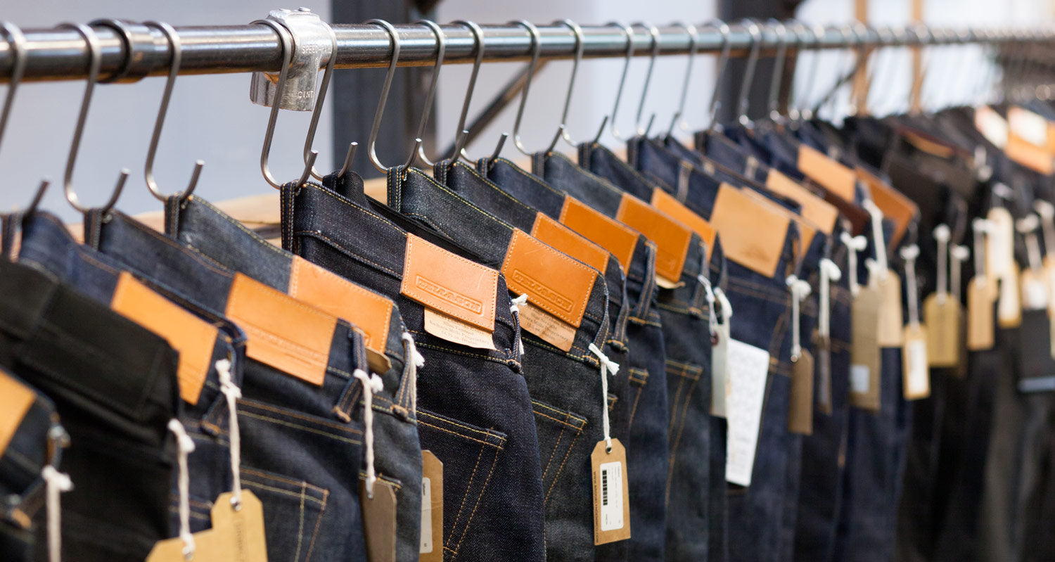 Store display of Tellason raw selvedge denim jeans made in the USA at Brooklyn Denim Co.