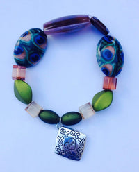 "Awareness of Causes green beaded bracelet with ""love"" charm - The House of Awareness"