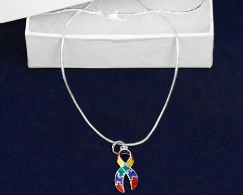 Puzzle Charm Necklace for Autism Awareness paired with Hoop Earrings - The House of Awareness