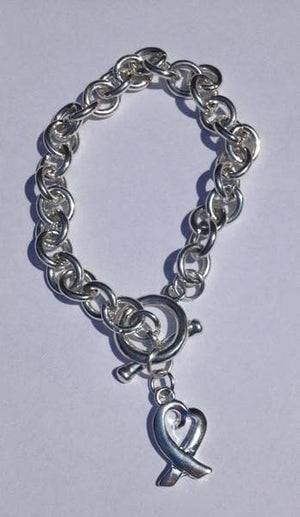 Silver Bracelet with a Heart Ribbon Charm for Mental Health Awareness - The House of Awareness