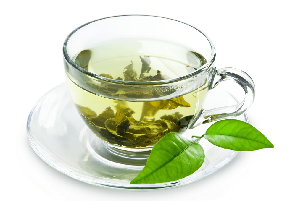 Green tea cup with tea leaves