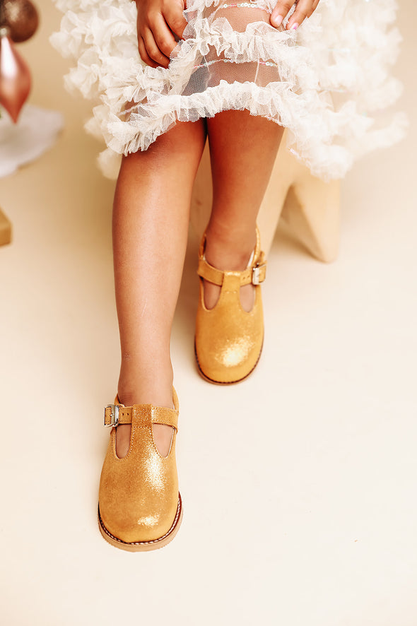 the hard soled t-strap: gold shimmer