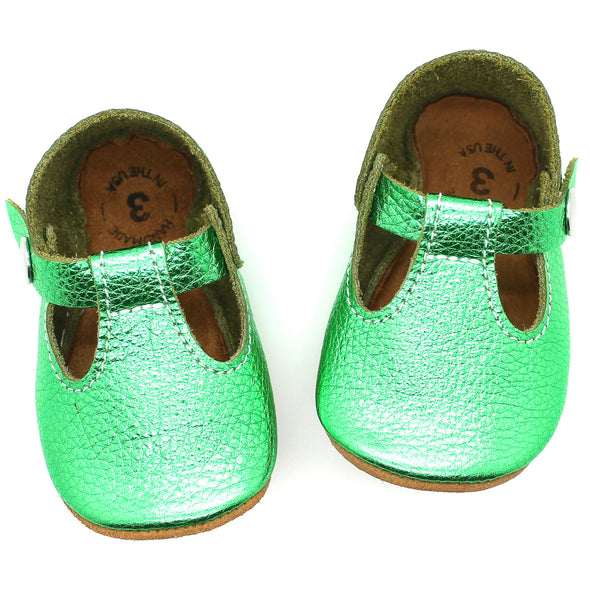 the original soft-soled t-strap: shiny emerald