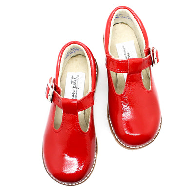 the hard soled t-strap: candy apple