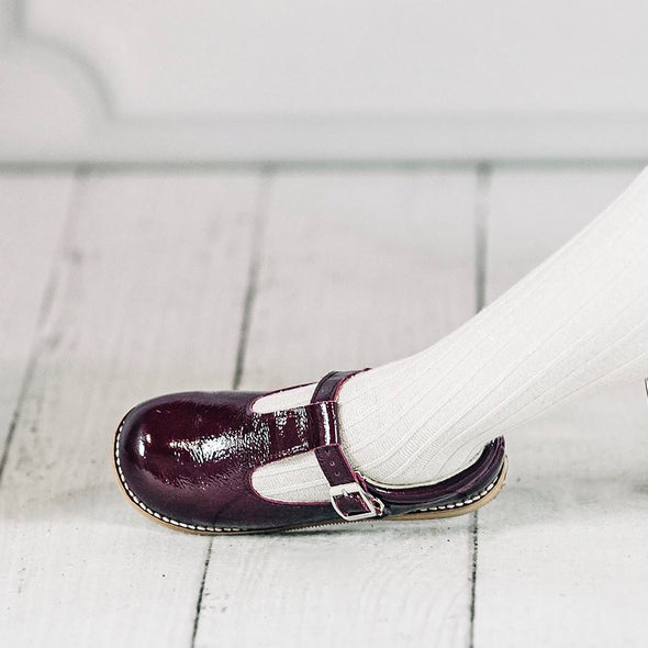 the hard soled t-strap: patent plum