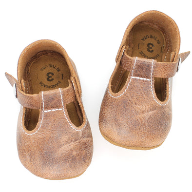 the original soft soled t-strap: weathered brown