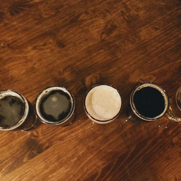 Beer tasting flight on a table from a top-down view