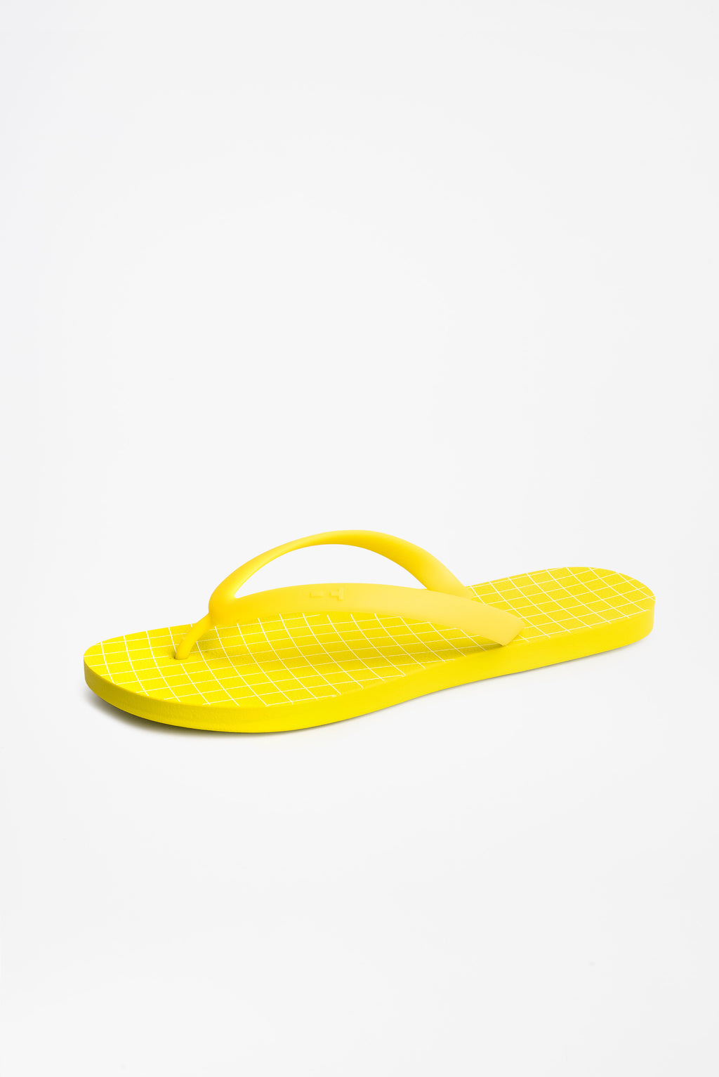 Side view of men's flip flops in acid yellow with a white grid pattern