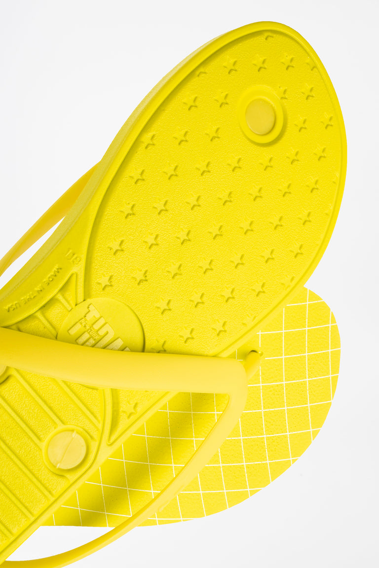 Yellow men's flip flops with durable, extra soft soles.