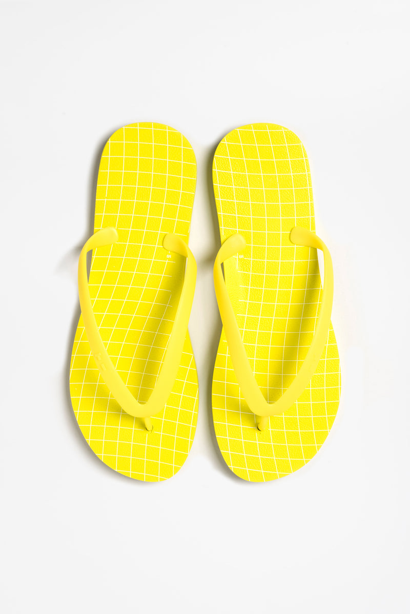 Sustainable mens flip-flops in yellow. Made in America