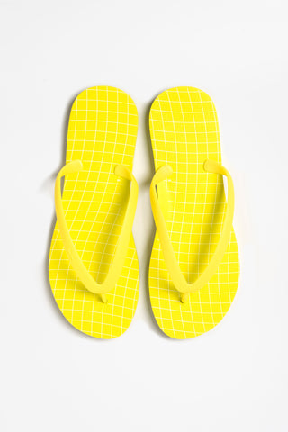 Yellow wavegrid flip flops by Tidal NY. Available online today - shop the collection