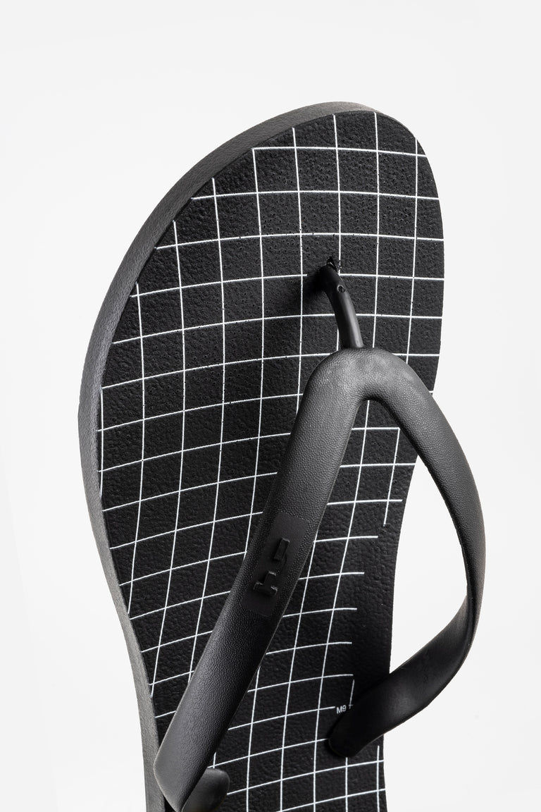 Graphing paper flip flops in black.